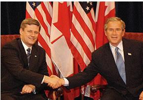 Harper and Bush shake hands